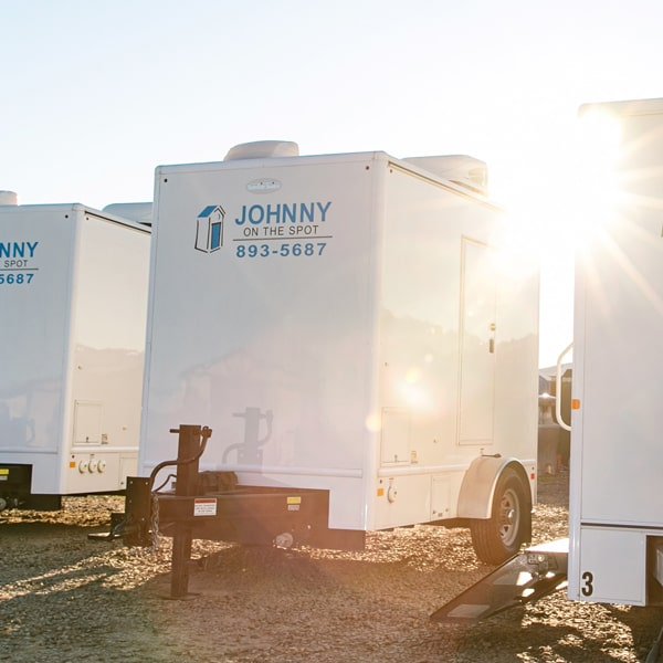 exterior of luxury unit with johnny on the spot logo