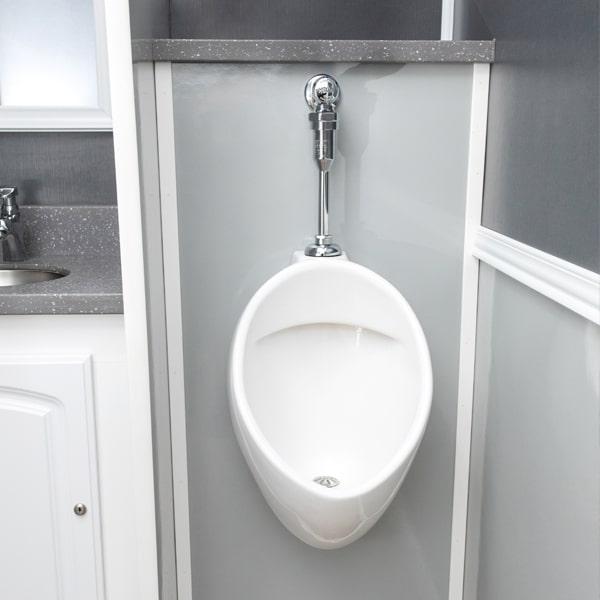 urinal inside luxury restroom trailer