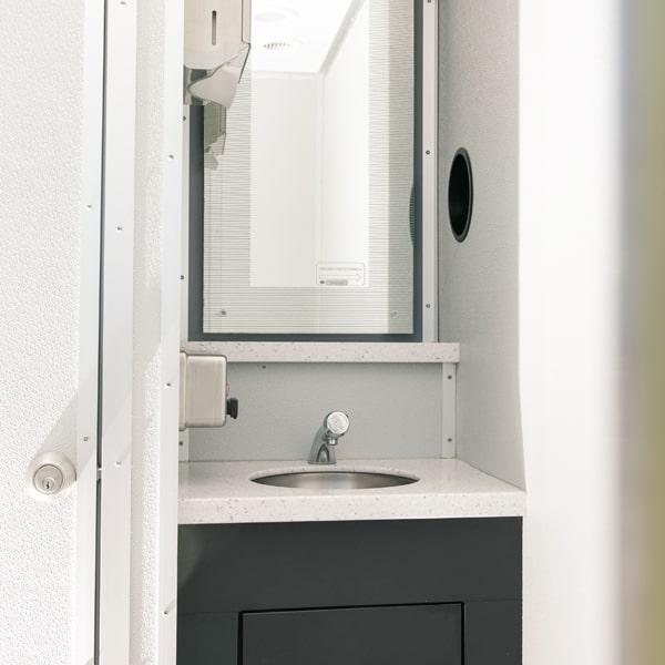 sink and mirror inside luxury restroom trailer